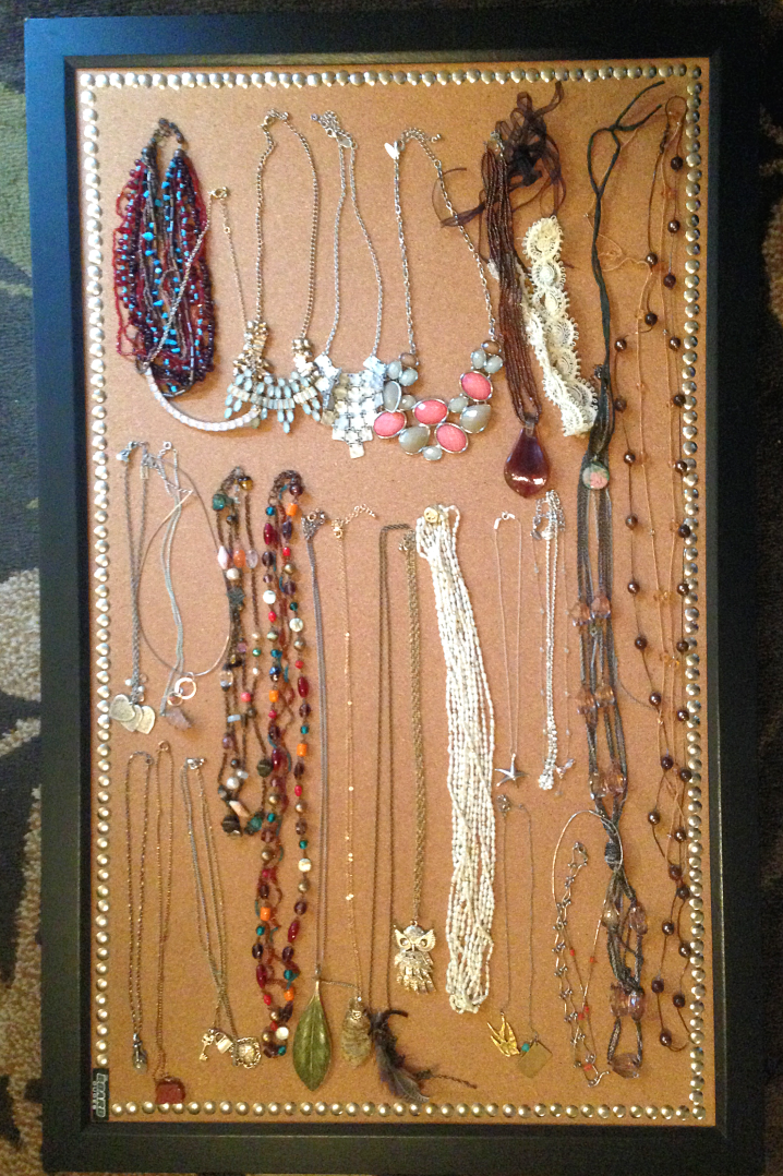 Jewelry laid out on bulletin board